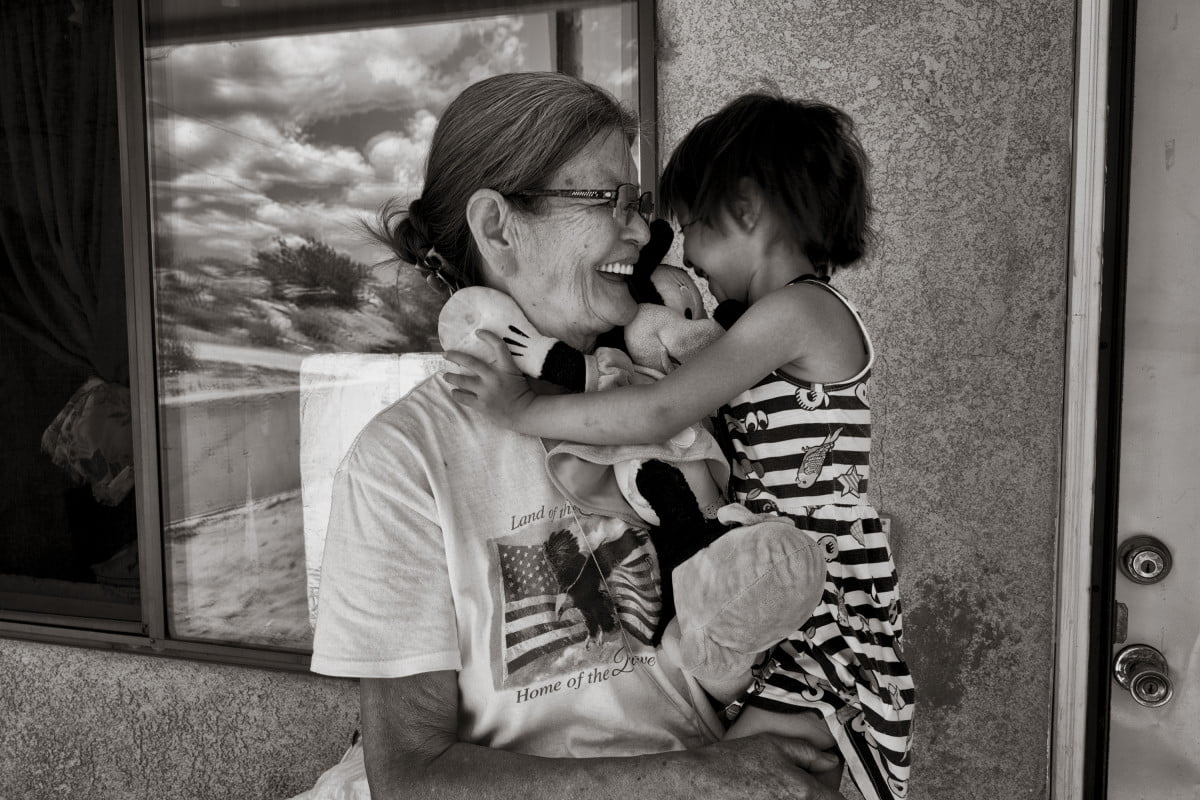 Kateri with her grandmother Shirley Yellowfeather at their house in Gallup.